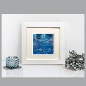 Raindrops making ripples on water - Art Print in Frame -